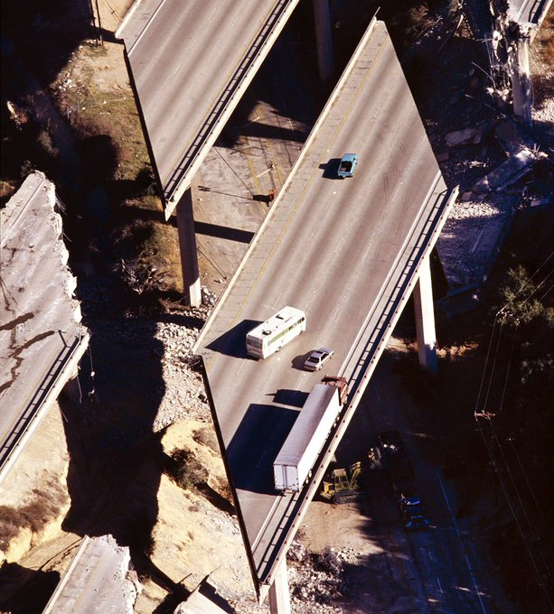 25 yrs ago at 4:30 a magnitude earthquake in Northridge, CA. killed 57 people, injured 8,700, and caused billions of dollars in damage. I took this from a helicopter over Rt. 14 where the freeway collapsed stranding motorists. It was the rudest wake-up call ever for me. Photo