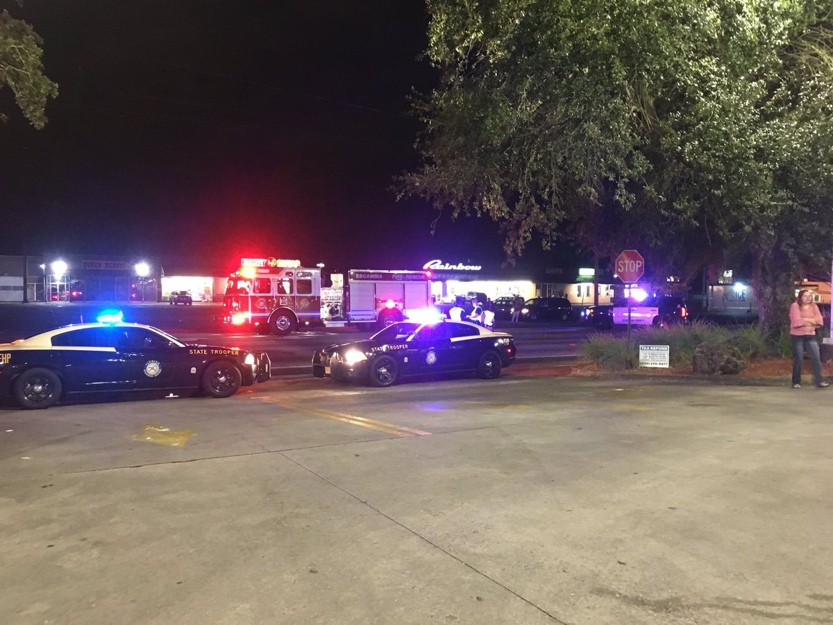 """BREAKING: Authorities are looking for the driver involved in the deadly hit &amp; run on Fairfield Dr. They believe he or she was in a white or light silver """"dually"""" truck. It may have damage to the front and side. If you have any info call FHP or Crime Stoppers at 433-STOP. @weartv<br>http://pic.twitter.com/wbFOBnuKQJ"""