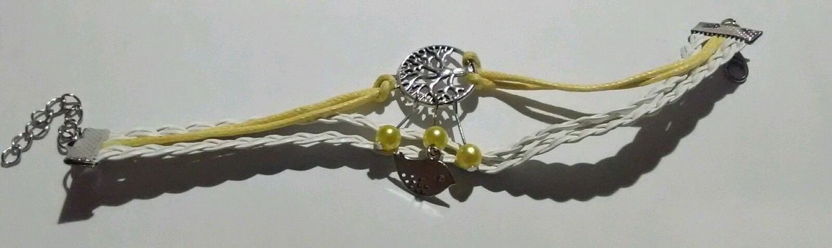 white yellow leather bracelet bird tree charm #forsale Direct message to make best offer or Link in profile to purchase.  #white #yellow #leather #bracelet #bird #tree #charm #jewelry #bling #accessories #fashion #design #love #style #ootd #ootn #styleblog #styleoftheday