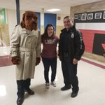 Image for the Tweet beginning: Officer Stephen Parra and McGruff