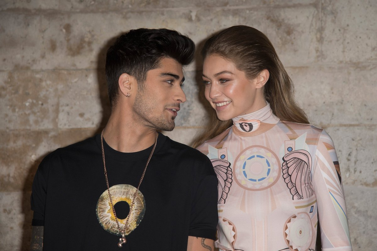 """Weeks after reports surfaced that Zayn Malik and Gigi Hadid split, the model was spotted leaving the """"Let Me"""" crooner's apartment. Wait, what? >> https://t.co/WMBHzu0NRF"""
