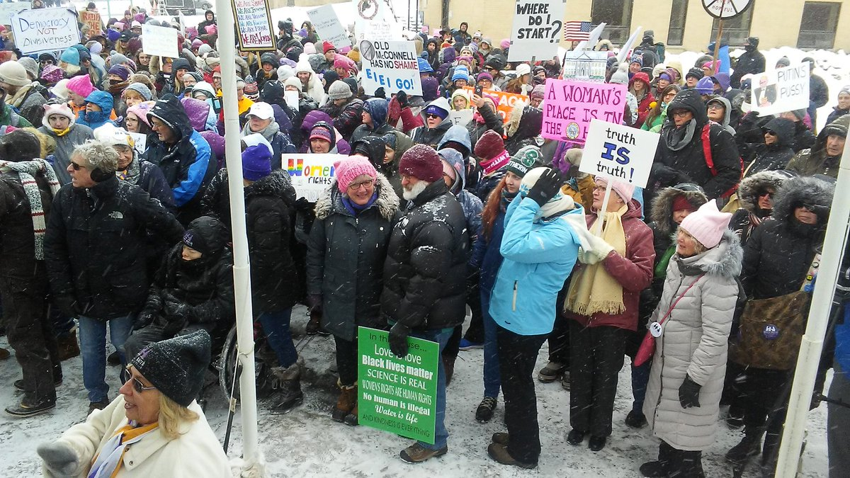Women (and men) march in snow & cold in Seneca Falls