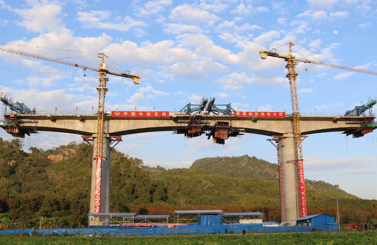Chinese firm completes beam closure along China-Laos railway. The 414 km railway links northern border of Laos with capital Vientiane http://xhne.ws/GQdIO