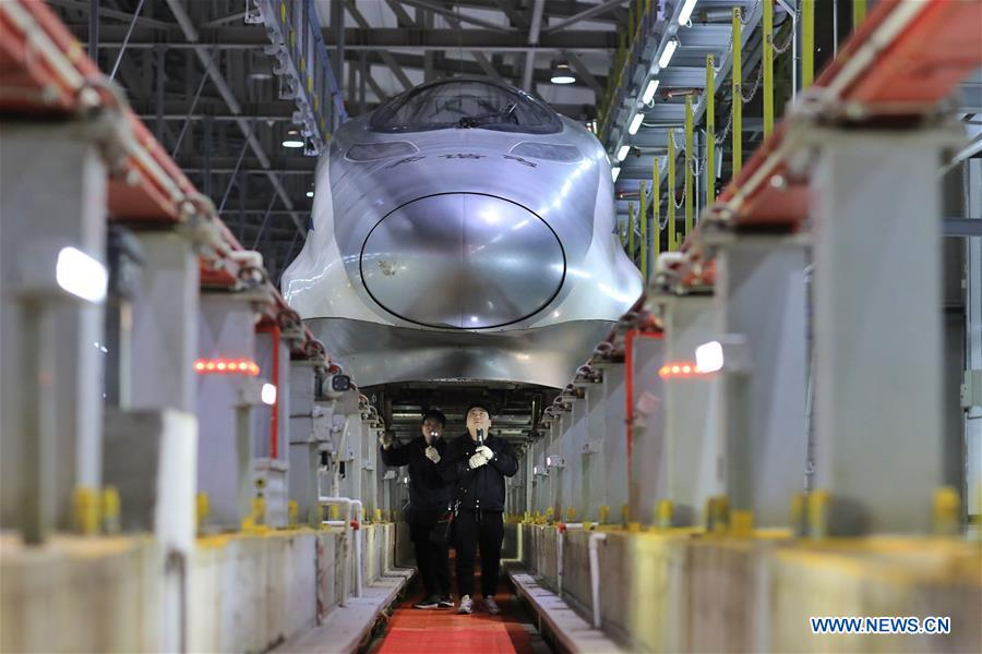 Mechanics check on bullet trains at a maintenance station to ensure safety for the upcoming Spring Festival travel rush in Guiyang, capital of southwest China's Guizhou Province on Saturday. (Xinhua)
