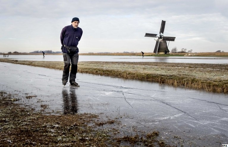 Skating on natural ice in the Frisian Ryptsjerkerpolder pond in Ryptsjerk, the Netherlands yesterday. Jo