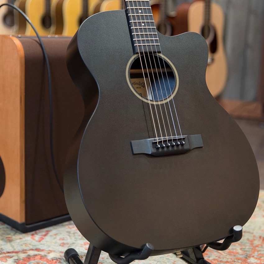 Made of forest-friendly Jett Black HPL, @MartinGuitar's auditorium body shape gets a matte-black makeover in the Custom X-000CE Sonitone Acoustic/Electric - $70 off through 1/23! #MartinMonday https://t.co/8qYHdwGsrp