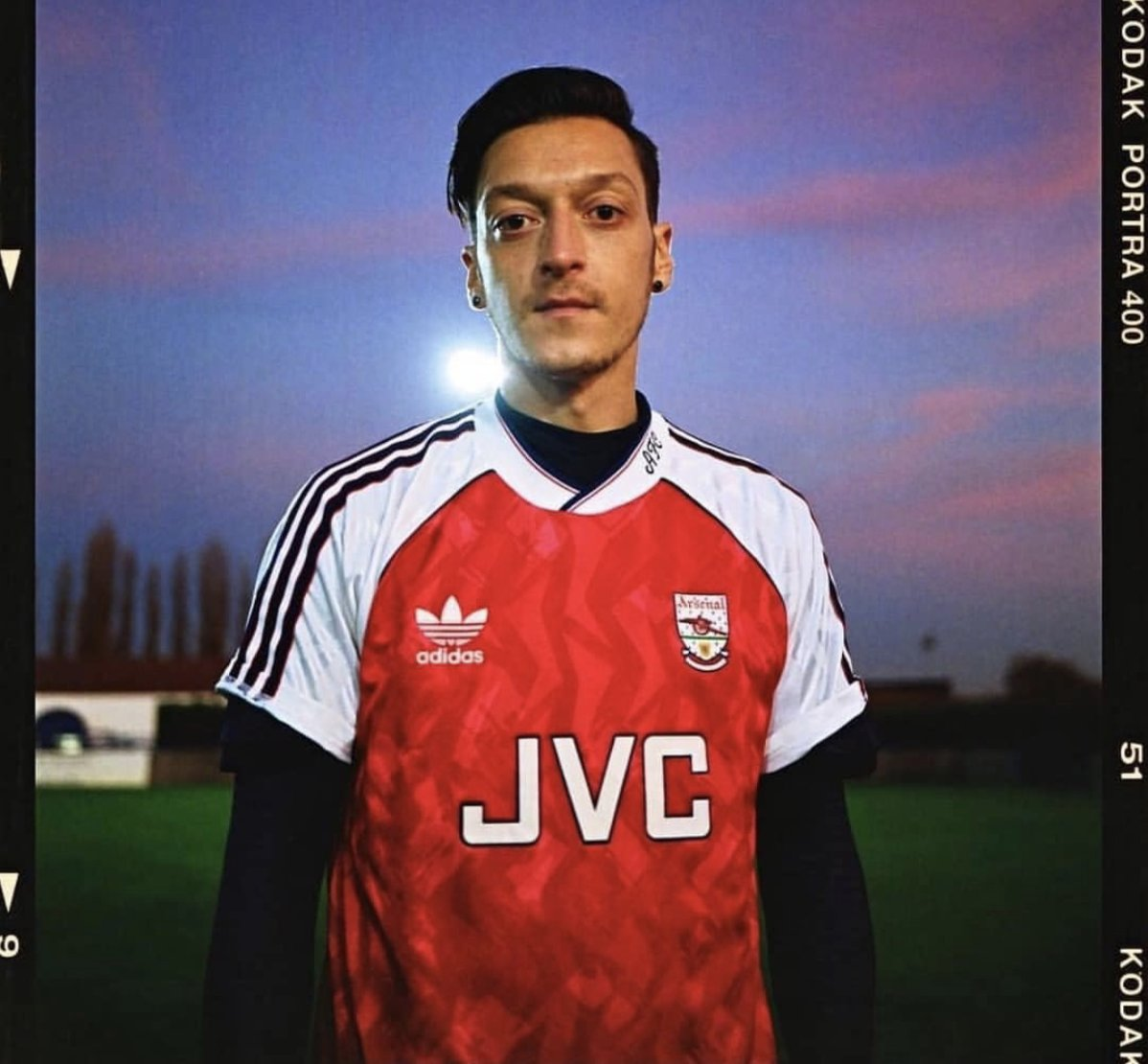 f4bd54af34e As Arsenal get ready to move to Adidas, there was much excitement when  Mesut Ozil was pictured wearing a retro Adidas Arsenal jersey.
