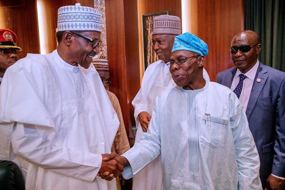 Dxg1tTOX0AEbyQ  - After blasting Buhari in open letter, Obasanjo shakes hand with him in National council of state meeting (photos)