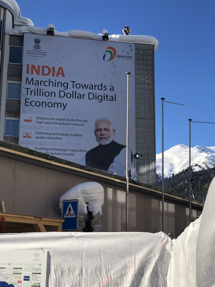 If it's January it must be Davos. The clear, ultra-clean blue skies are always a welcome bonus. As is this larger-than-life poster of @narendramodi as I enter the main Congress Centre.