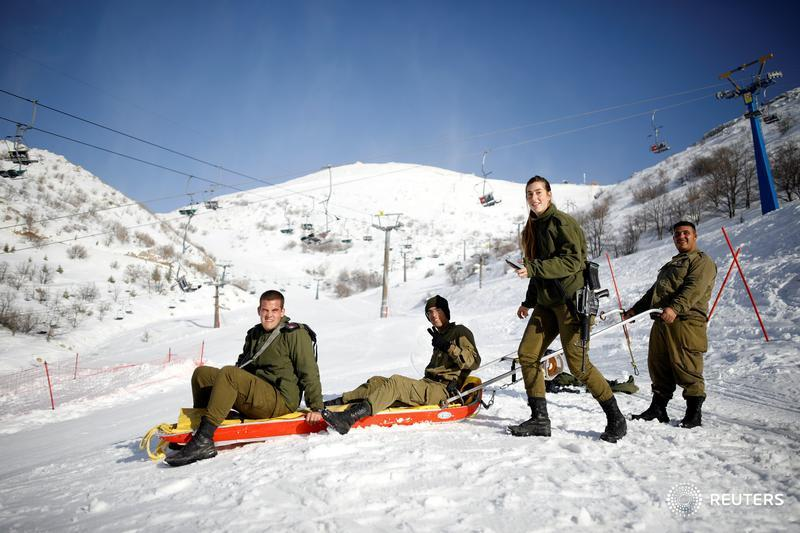 Israeli soldiers put each other on a sleigh on Mount Hermon in the Israeli-occupied Golan Heights, near the Israel-Syria border, and more photos of the day: http://reut.rs/2sFhW7O  📷 Amir Cohen