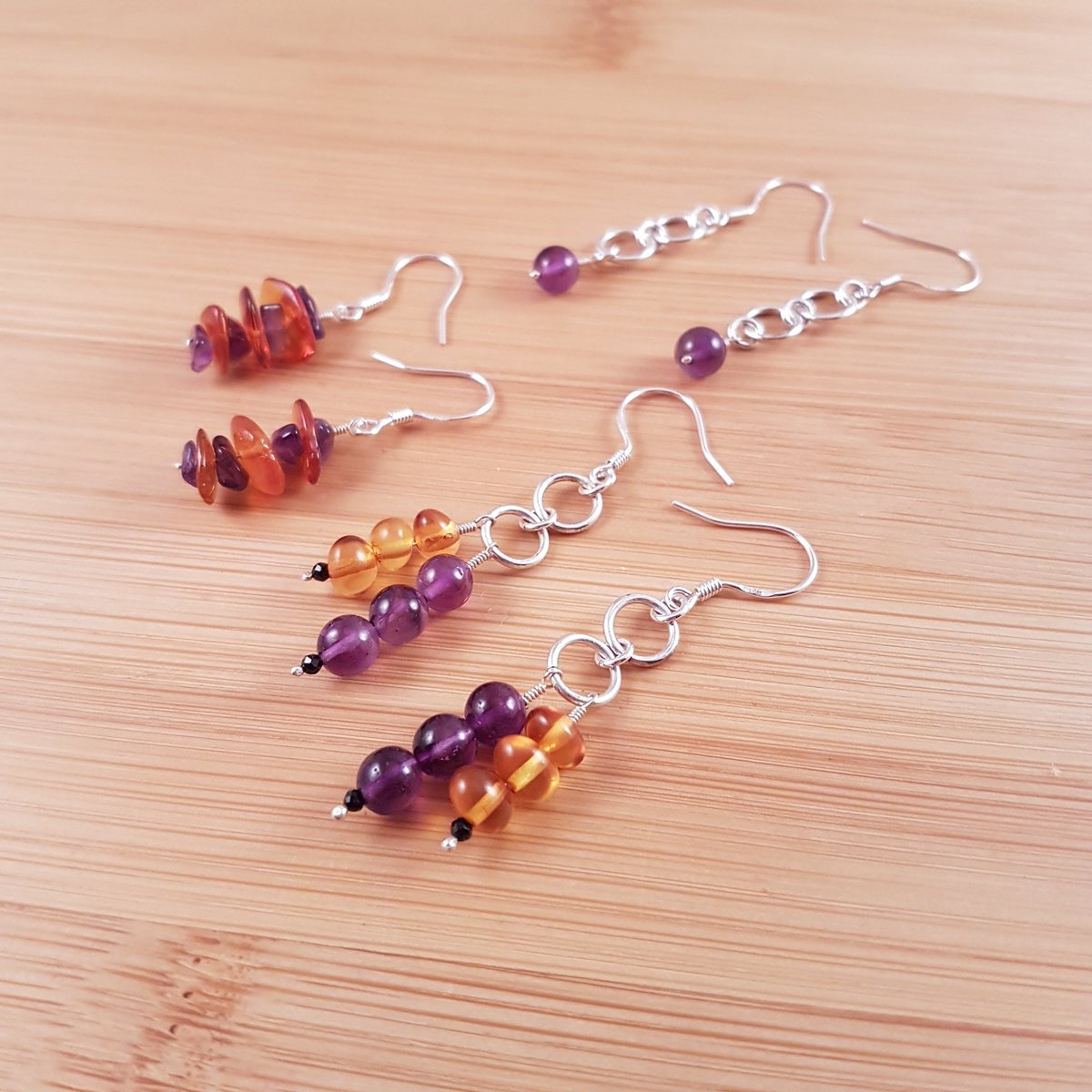 Amethyst and amber earrings laid out