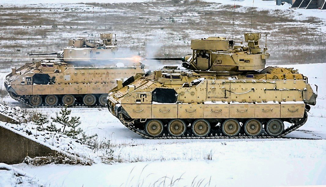 Who's ready for a #snow day?  A #USArmy Bradley Fighting Vehicle crew with 1st Armored Brigade Combat Team, @1stCavalryDiv fires rounds down range during a live fire exercise at Camp Aachen in Grafenwoehr, #Germany #TuesdayTraining  U.S. Army photo by Sgt. 1st. Class Ron Lee