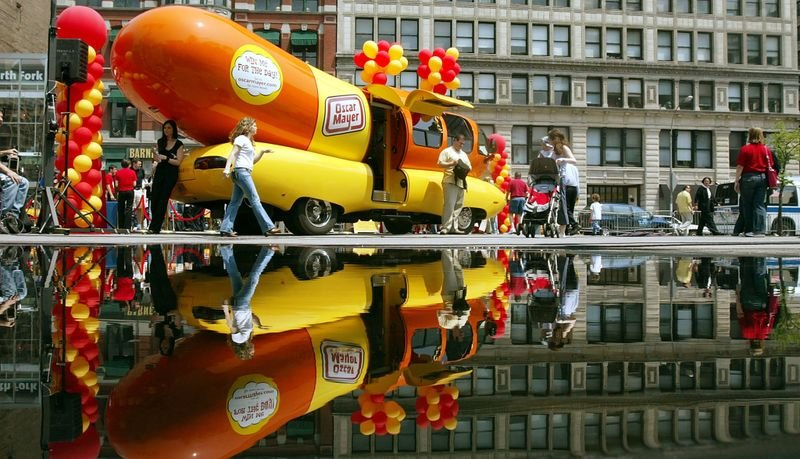"""Journalism degree? Drive the Oscar Mayer Wienermobile!   The unusual ad is chockfull of clever wordplay, offering a those with """"an appetite for adventure"""" to apply for a gig they can """"relish"""" if they can """"cut the mustard."""" The official job title is """"Hotdogger"""""""