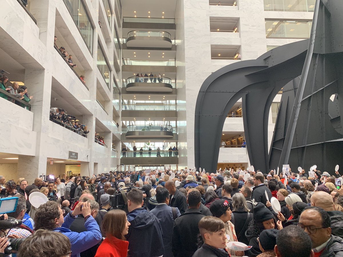 """Meanwhile, down the street at the Hart Senate building there is a major protest against the shut down, with demonstrators yelling """"No more food banks—they need pay checks!"""""""