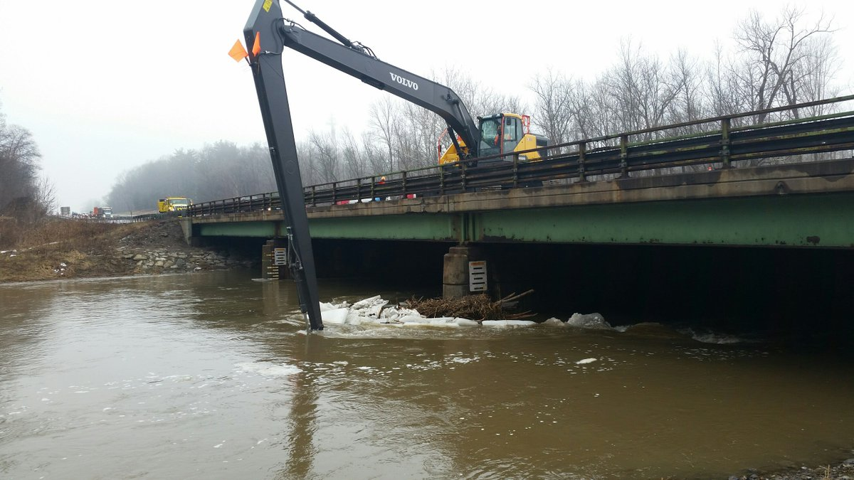 Highway crews work to clear ice from Thruway bridge pier (photo)