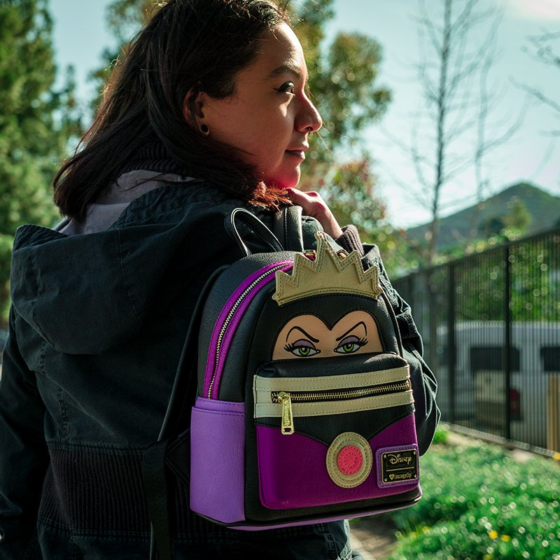8b2891df511 Show off your wicked side with this  Loungefly Snow White Evil Queen Face  Mini Backpack