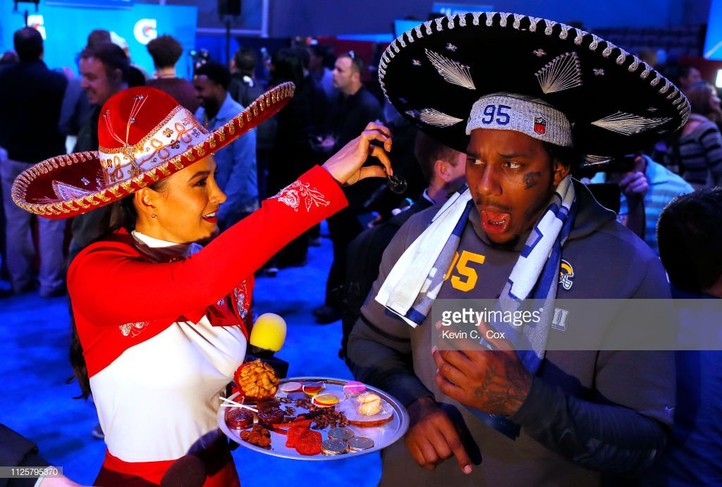 Ethan Westbrooks of the @RamsNFL reacts as he is offered a scorpion from a reporter during #SuperBowl LIII Opening Night  📷: Kevin C. Cox