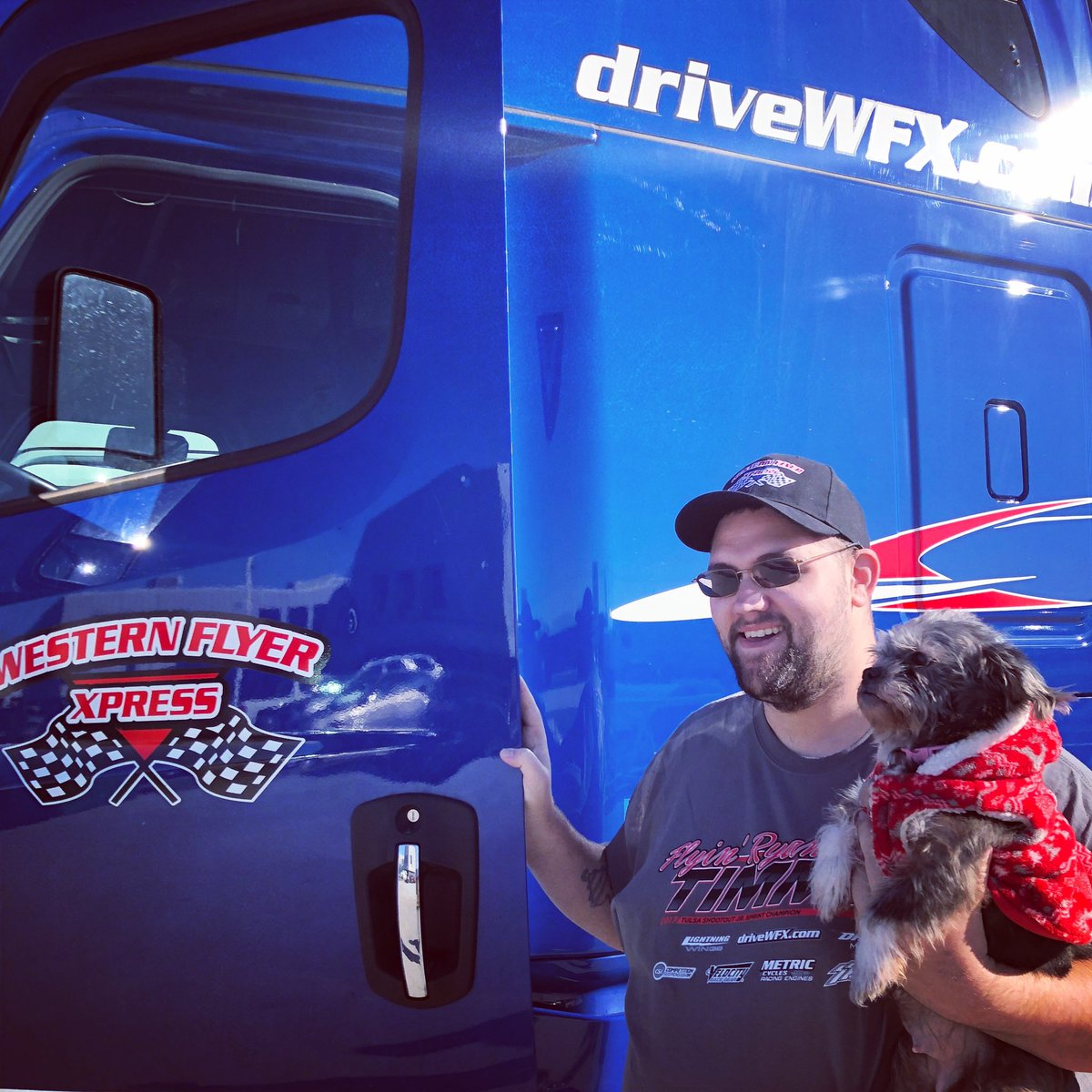 Chris gets ready to hit the road with his dog dressed for the cold weather❄️❄️! Stay warm and safe out there! . . #driveyourdream #cdldriver #18wheelers #otrdriver #leasetoown #cdlcontractor #driveWFX #petpassenger #dogs #dogonboard #trucks