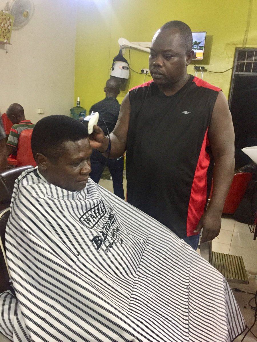 """Having a haircut in Gulu in preparation for the Thursday Jinja presser to launch the Jinja DP Reunion Drive...and of course #NBSFrontline. Meet my trusted barber commonly known as """"Aphib"""". Find him at Shaven Salon, Gulu: He is a man committed to excellence in his trade."""