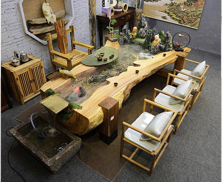Bồ bàn ghế bằng gỗ Long não kết hợp non bộ sơn thủy mang đậm nét phong thủy độc đáo