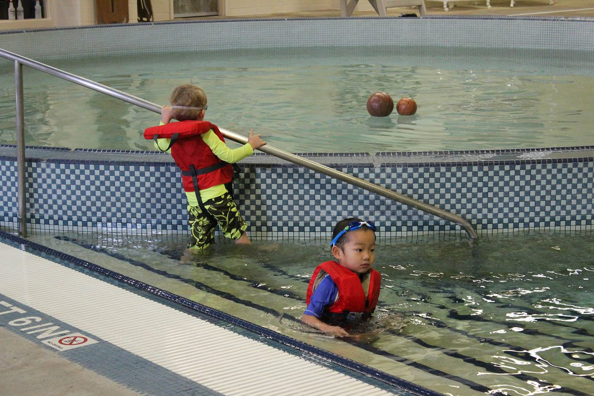 [Image Description: Two children in Cary Street Gym Aquatic Center.]