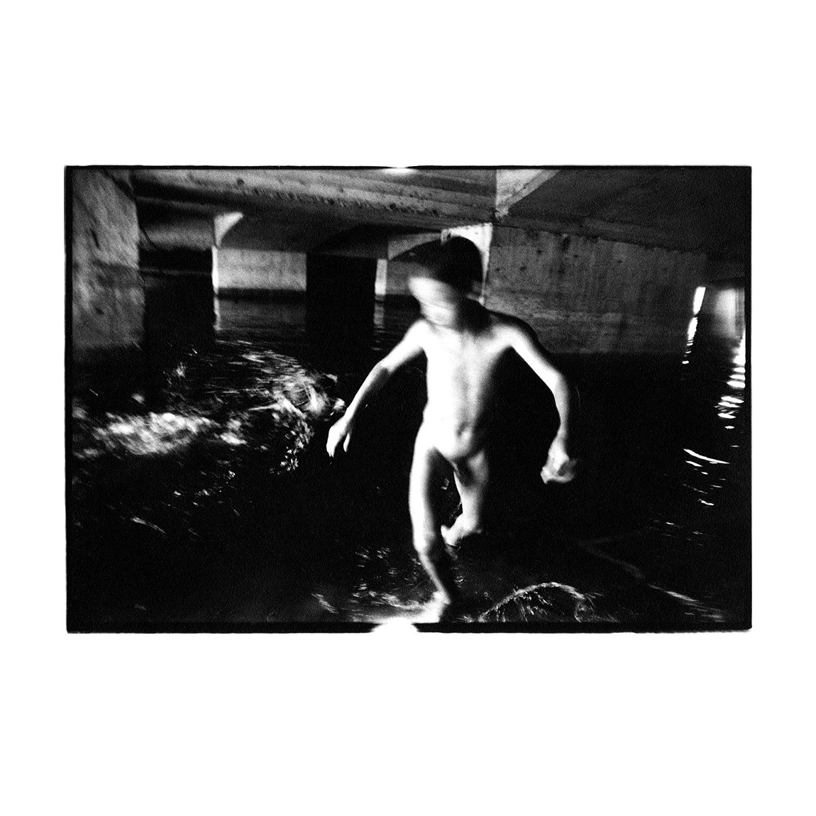 Dâmboviţa River, Bucureşti, Romania. August 1992  B&W #analogue #Documentary & #Reportage #photography   All images are shot with a Nikkormat & 24mm lens using @Kodak TMax 400. Images are printed by the #photographer & are uncropped.  http://TobyDeveson.com  #BelieveInFilm #Film