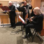 """It's Friday & time for Happy Hour! Today we're thrilled to have """"The Sax of Us"""" entertaining residents, family and staff in our main lounge! #TGIF #HappyHours #augustinehouse #forbetterretirementliving"""
