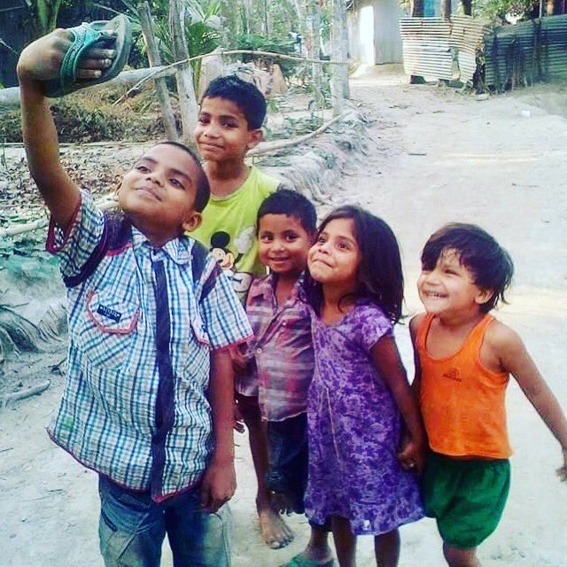 I'm sharing this image that came in on text cause d unbridled innocence n joy of these lovely kids moved me n made me smile in equal measure  Super image that asks questions  If anyone can reliably locate these munchkins n d photog I'd love to personally send them something each