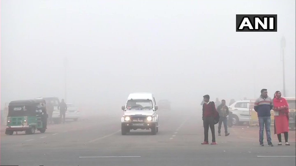 Dense fog shrouds the national capital affecting flight and train operations  Visuals from Delhi's Rajpath area (📸: ANI)