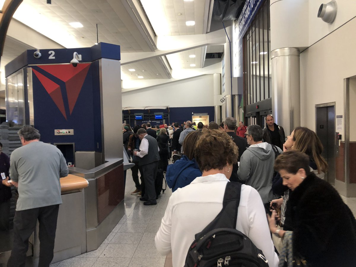 This is the craziest I've ever seen #ATLAirport. Security lines are almost outside the airport. If you're checking bag, those lines are long too. This is line for Clear AND TSA pre-check. Wraps around where you check bags. Regular security line is about 20x worse. #SBLlll #ATL<br>http://pic.twitter.com/Mzaw9Dm5uV