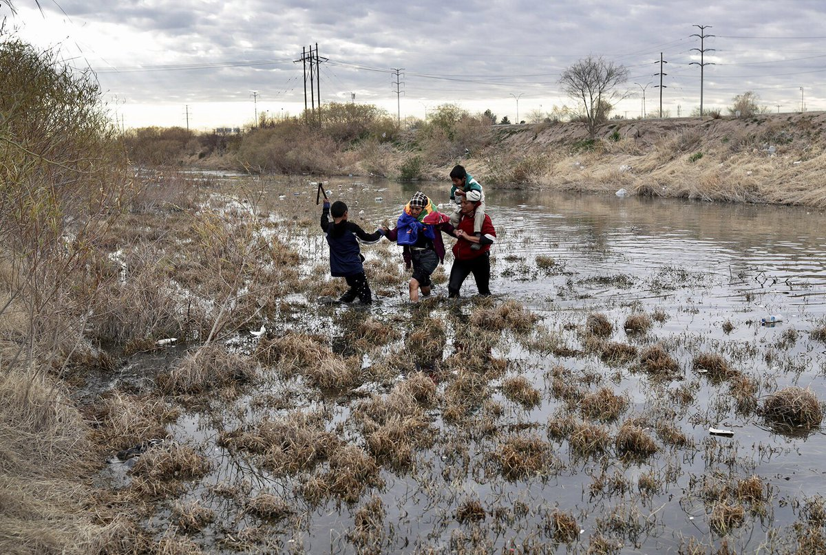 Central American immigrants wade across the Rio Grande, which forms the US-Mexico border and walk along the border fence, located about 100 yards inland from the river, to request political asylum in the U.S. #Immigration #undocumented #Border #gettyimages @GettyImagesNews