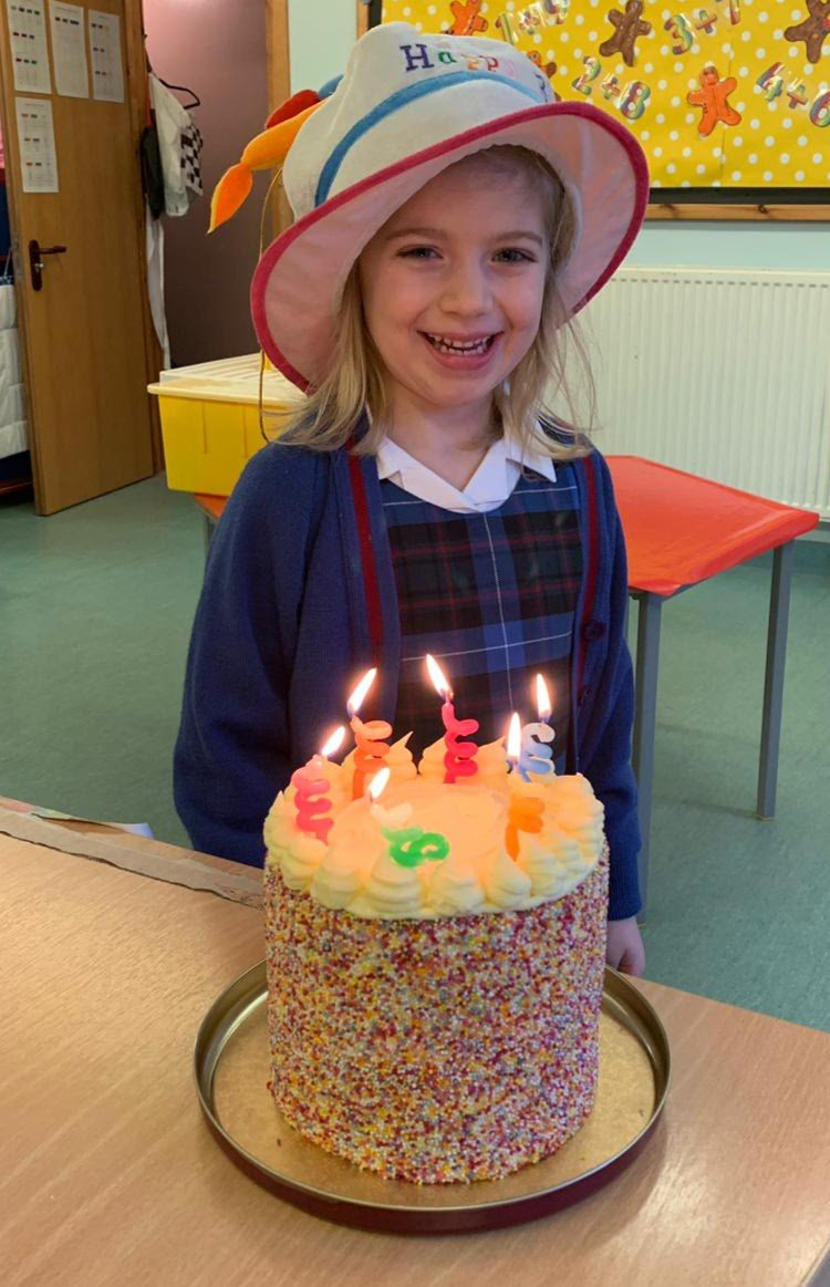 We encourage all the children to celebrate their birthdays in school. Today Ella's wearing the #birthday hat and look at the cake she brought to school to share with her friends! #CraigclowanFamily #yum