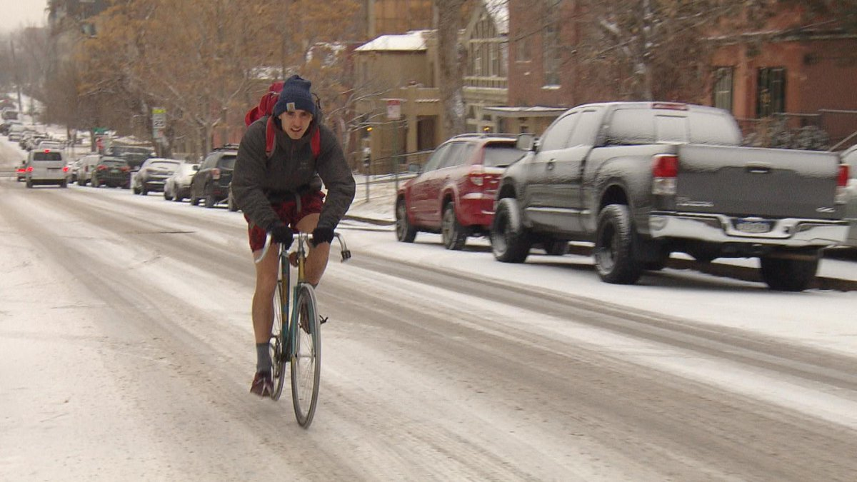 This guy wearing shorts and riding his bike in the snow is 100% PURE COLORADO.  #4wx #Denver #cowx
