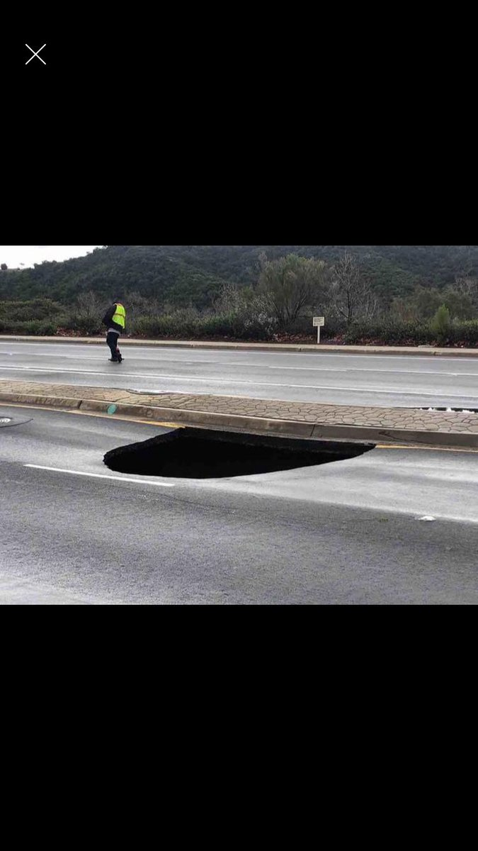 Sinkhole in our San Diego neighborhood! I'm calling it #pitofdespair. #princessbride #robreiner