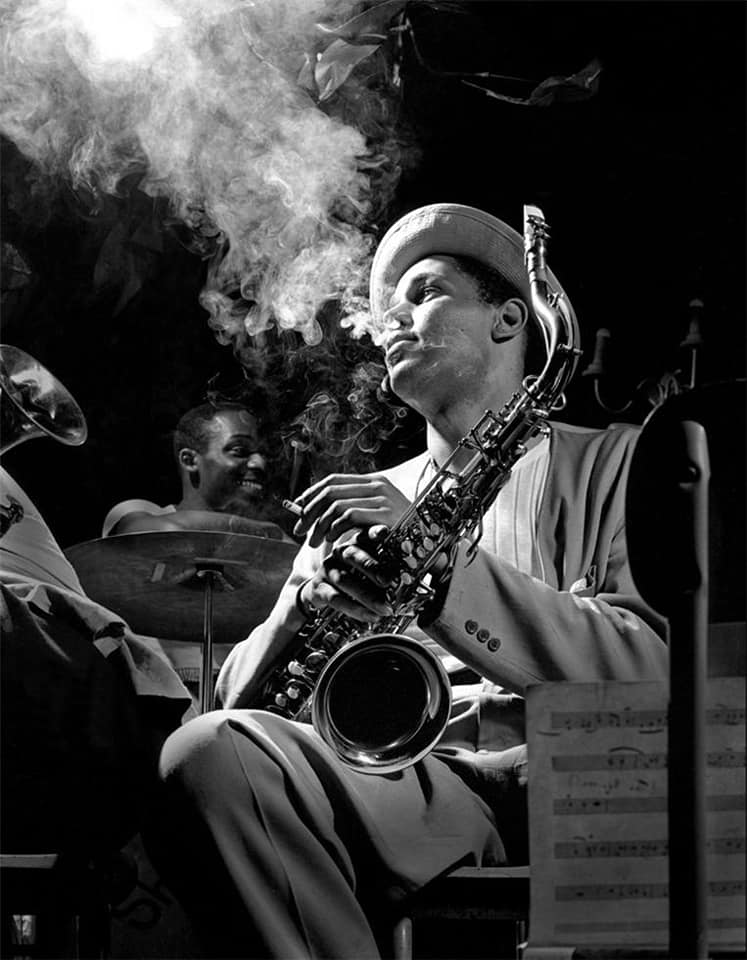 Photo (1)Dexter Gordon New York 1948.- Photo (2)Duke Ellington Olimpia Theatre Paris France 1958.- Photo (3)Ella Fitzgerald at the Downbeat Club in NYC 1948.- Photo (4)Stan Getz Tommy Potter Al Haig NYC New York 1949.