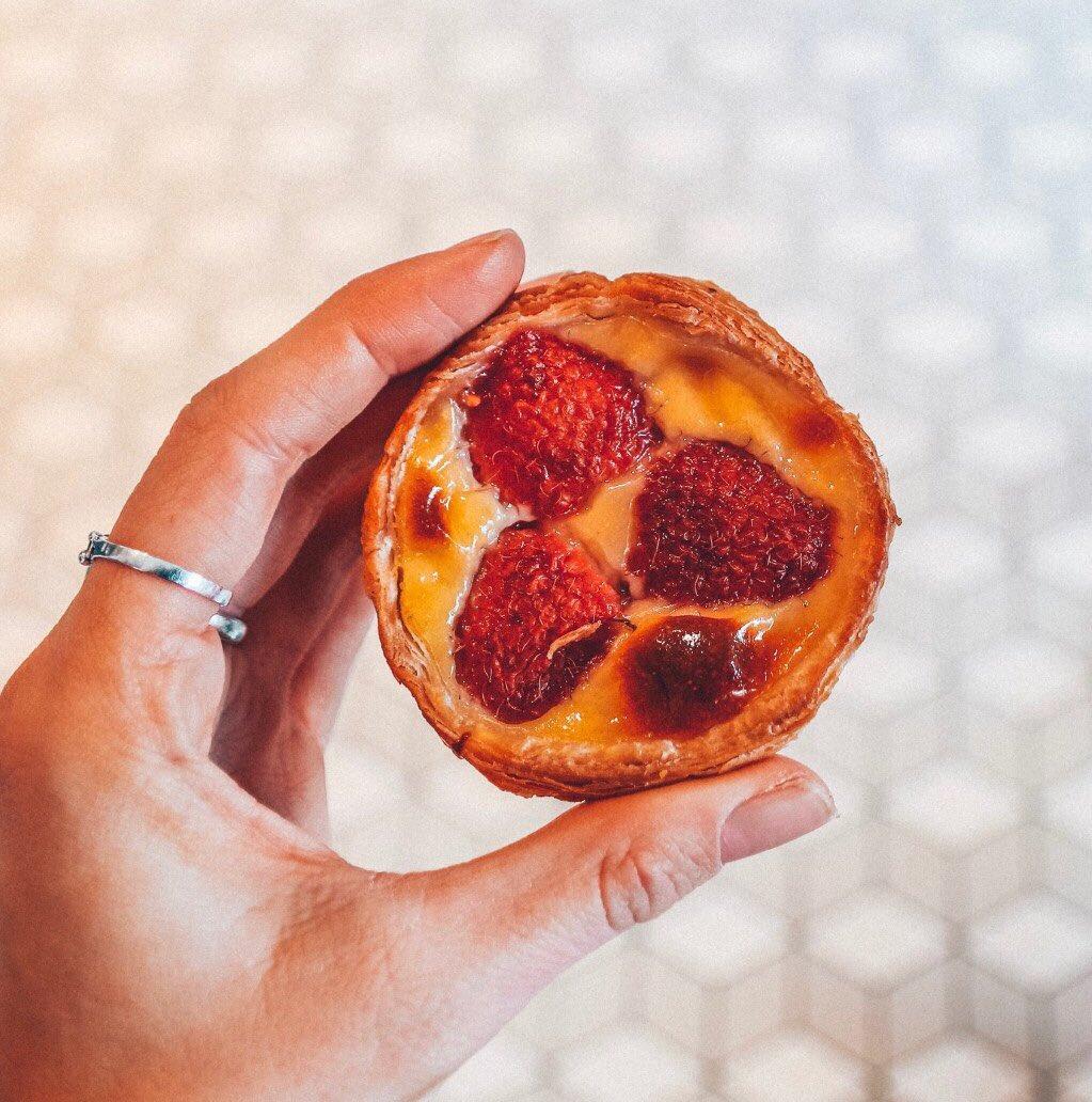 "Meet the Raspberry Nata one of your morning favourite ""pick me ups"" ❤️ 📸 by @SolrPowrdBlonde #pasteisdenata #raspberry #framboesa #coffee #cafe #pastelaria #delicious #valentinesday #gift #pickmeup #love"