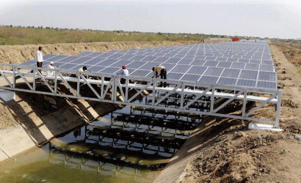 This is an intelligent application of solar panels in India.  No new land taken out of use and it reduces evaporation of the water in the aqueduct.