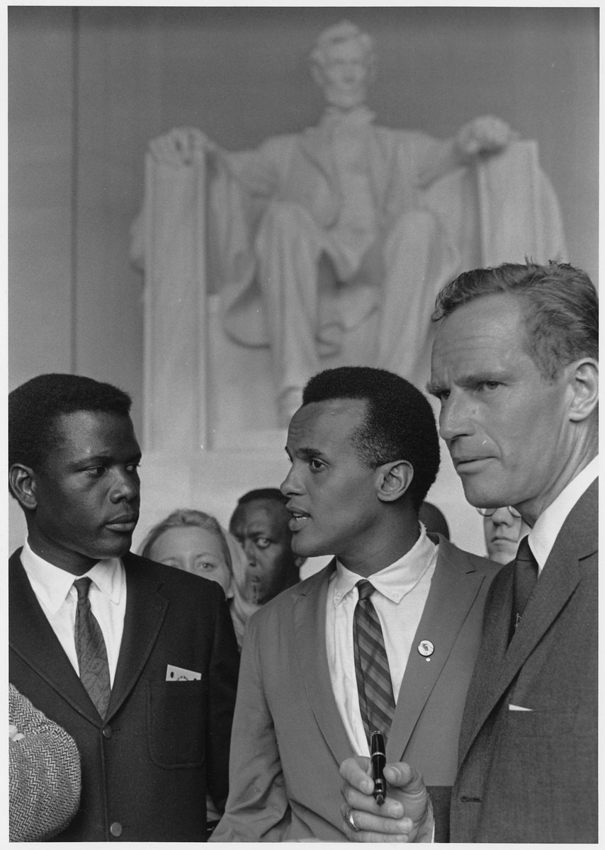 Happy birthday to a hero of entertainment. Actor, director and diplomat Sidney Poitier turns 92 years old today. (shown here with Harry Belafonte and Charlton Heston marching for #CivilRights) #HISTORY