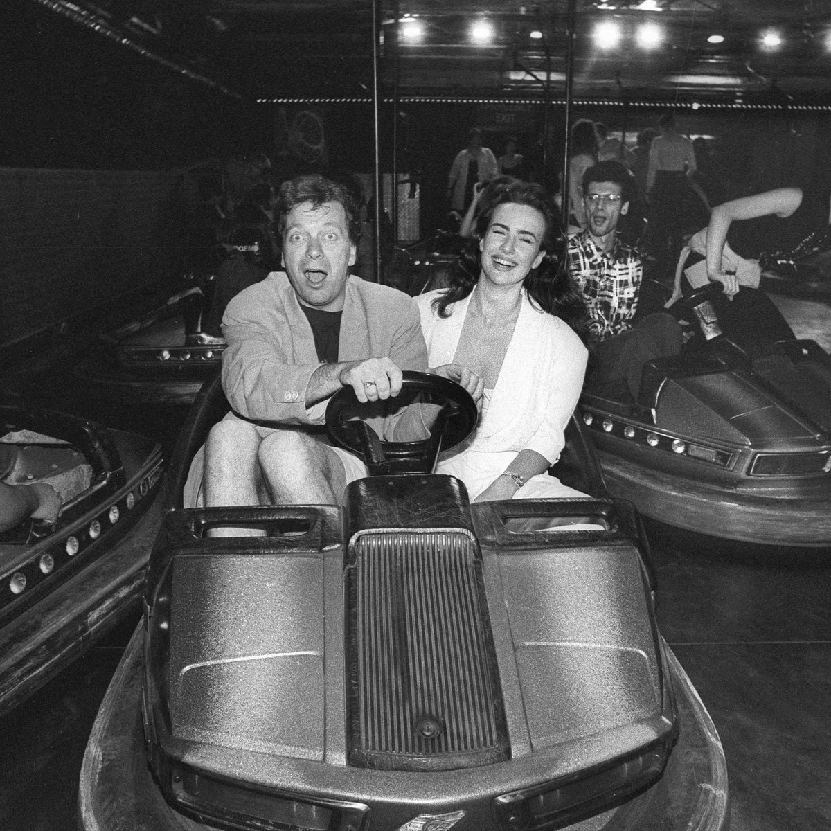 Today would have been Factory Records' co-founder #TonyWilson's 69th birthday. Here he is on the dodgems in The Haçienda in 1992, because of course they put dodgems in there.   Pic by Howard Barlow