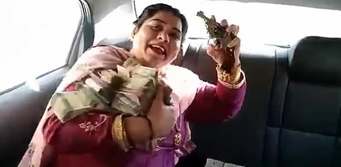 'Gangster' Indian Aunty shows off Lots of Cash and Jewellery with Gun  See VIDEO:  http://bit.ly/DB-indantygun  #indian #aunty #wealth #cash #money #gold #guns