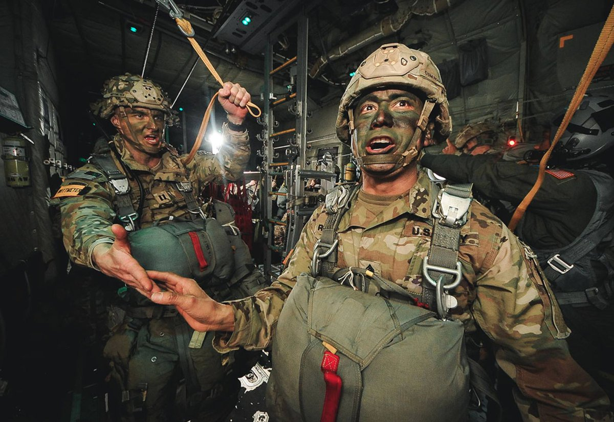"""Command Sgt. Maj. Delfin J. Romani of the 54th Brigade Engineer Battalion, 173rd Airborne Brigade, receives his last """"All OK Jumpmaster!"""" during an airborne operation in northern Italy, Jan. 31, 2019.  #Jumpmaster #Paratrooper #USArmy #Army #MilitaryMachine"""