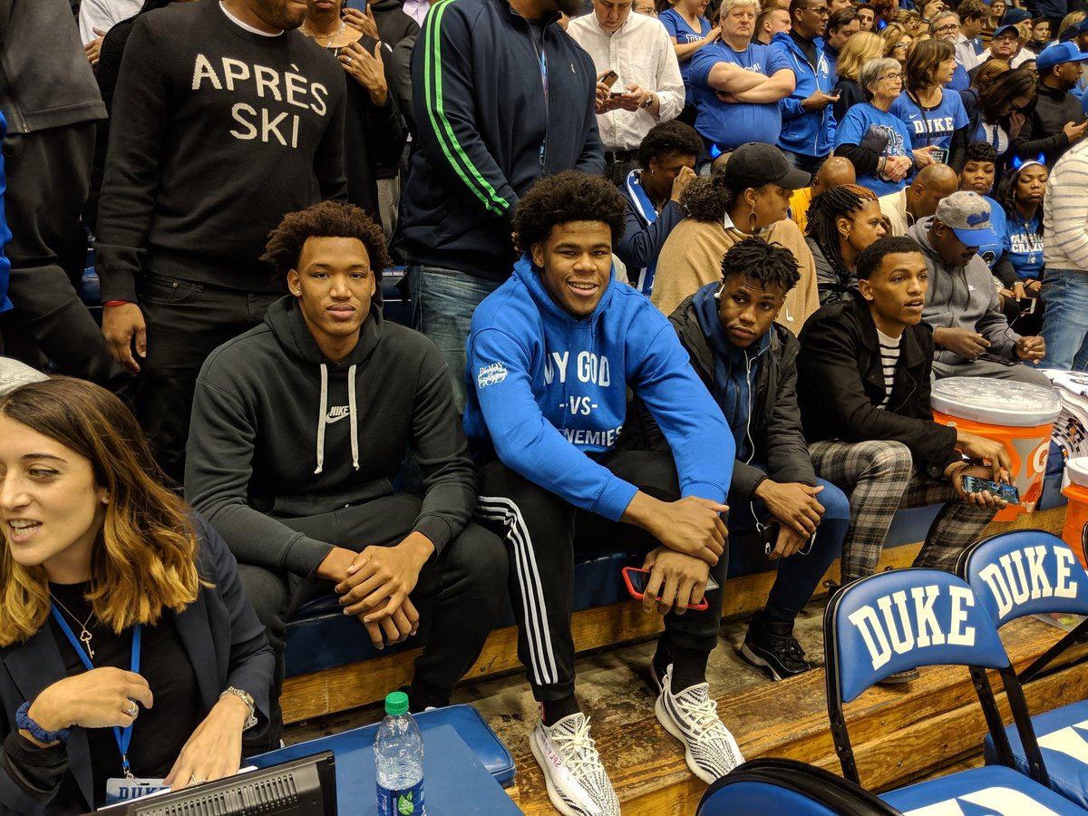 #Duke recruits behind the bench.
