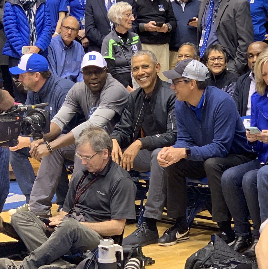 Barack Obama, the 44th President of the United States, smiling for the camera here at #UNC vs. #Duke because it is the greatest rivalry there is. #RivalryWeek – at Cameron Indoor Stadium