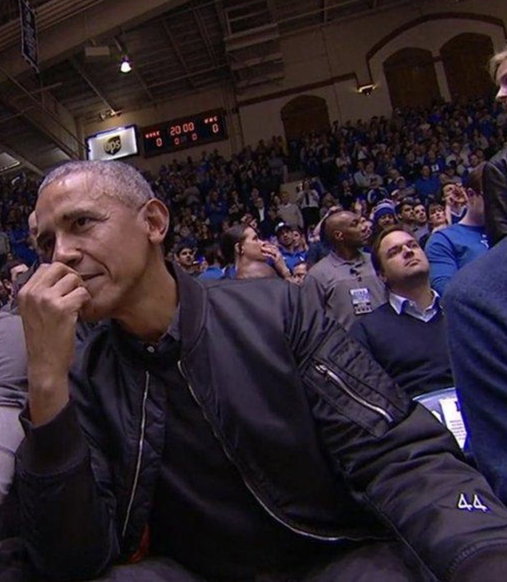 "Obama at the UNC/Duke game rocking an all black bomber jacket with ""44"" on the sleeve. 💧💧💧"
