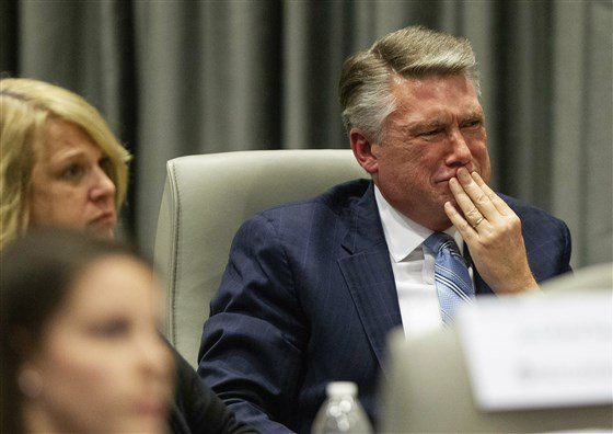 This is the photo of the day.  Mark Harris, Republican candidate in North Carolina's 9th Congressional race, fights back tears at the conclusion of his son John Harris's testimony.  John Harris said he warned his father about the illegal tactics.  This is a massive story.