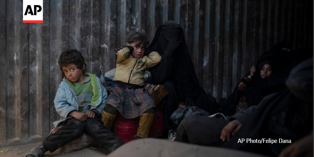 Children, looking terrified and exhausted, are among scores of people who have been evacuated from the riverside tent camp in eastern Syria that IS militants continue to hold on to.  http://apne.ws/fn1mkd3