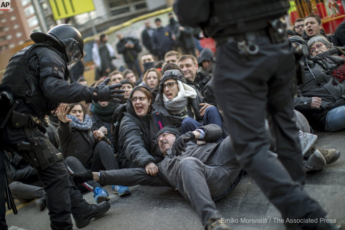 Catalan police officers remove demonstrators blocking a road leading to Barcelona city, during a general strike in Catalonia, Spain, Thursday, Feb. 21, 2019. (AP Photo/Emilio Morenatti)