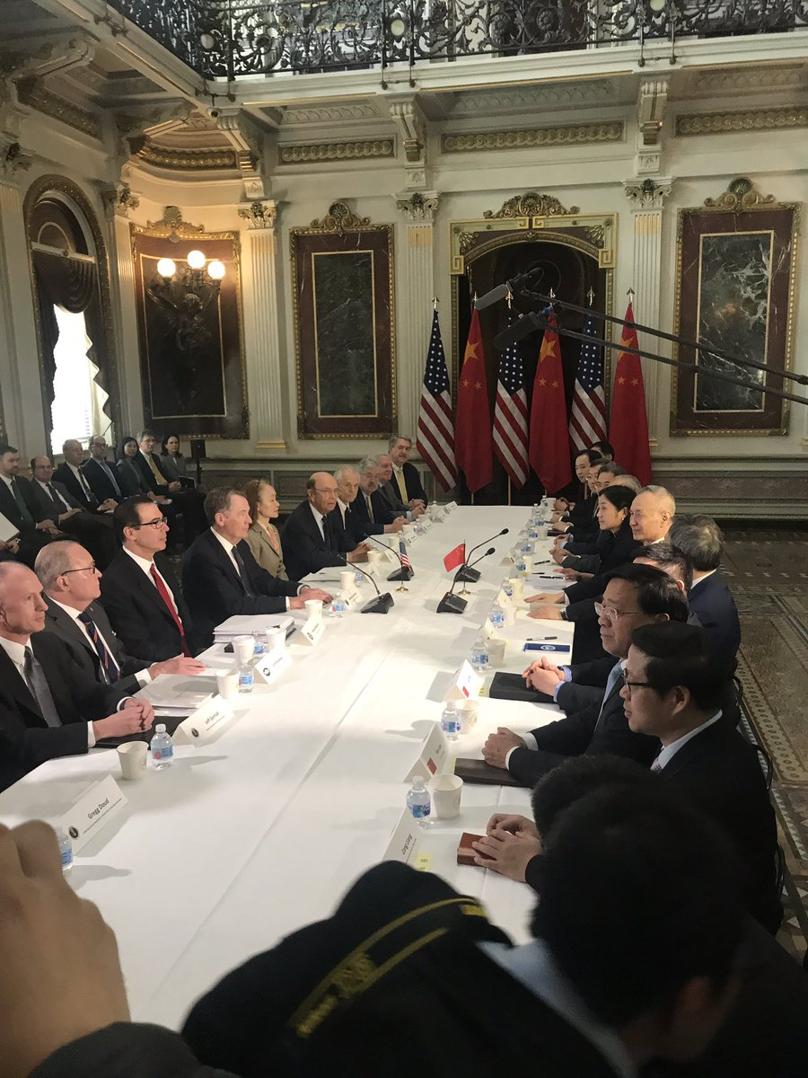 There are only two women at the table for US-China trade talks. They are the interpreters.