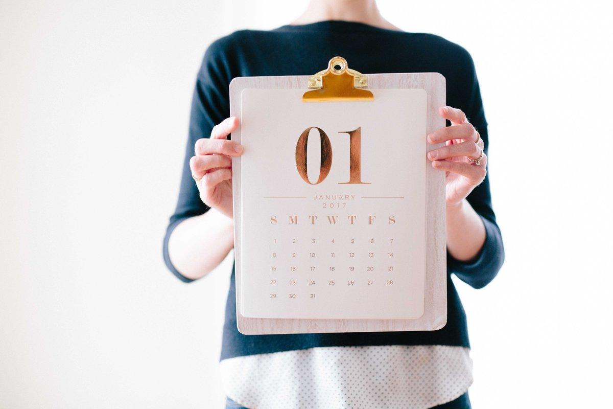 A person holding a calendar
