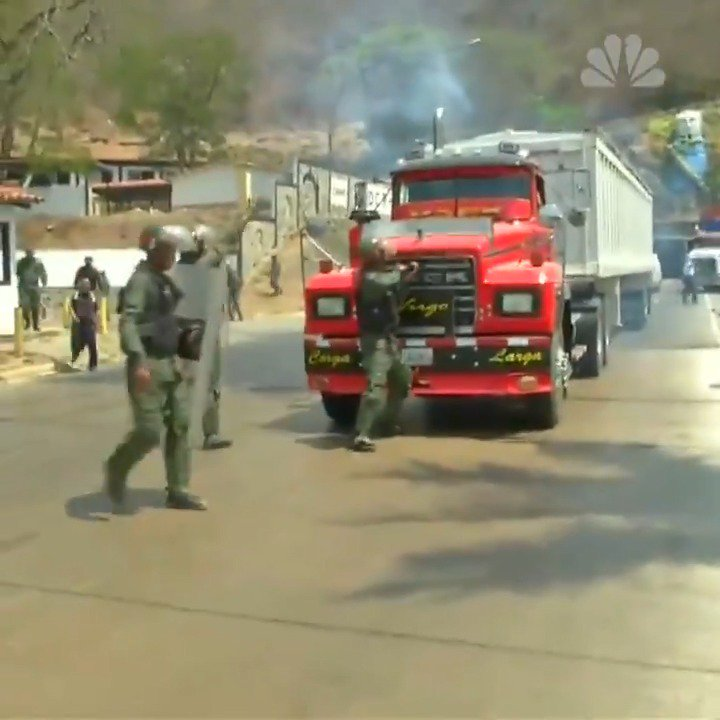 WATCH: Venezuelan troops try to block a convoy headed to the Colombian border to collect humanitarian aid.